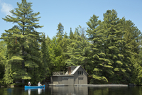 Canoeists approaching Boathouse, Smoke Lake, Algonquin Provincial Park, Ontario, Canada