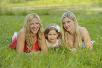 Cloase-up of Woman with her daughter and her mother in summer, Bavaria, Germany.