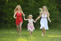 Woman with her daughter and her mother in summer, Bavaria, Germany.
