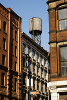 Water tower and buildings, Soho, (corner of Broome and Wooster Streets) New York City, New York, USA