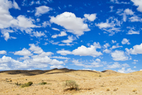 Namib desert with white, puffy cloud filled sky, Namibia, Africa