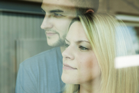 Close-up of Young Couple Looking out Window, Mannheim, Baden-Wurttemberg, Germany