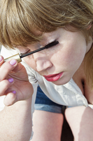 Close-up of woman putting on make-up