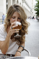 Young Woman Sitting and Drinking Beer at Outdoor Cafe Table, Zaragoza, Aragon, Spain
