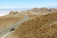 Illustration of car problem on an isolated desert road, Atacama Desert, Chile