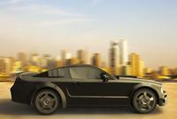 Illustration of sports car speeding in front of New York skyline, New York City, New York, USA