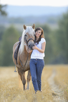 Young Woman Standing beside Haflinger Horse in Threshed Cornfield, Bavaria, Germany