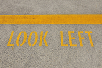 Look Left Sign on Street, Auckland, North Island, New Zealand
