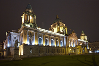 The Baroque revival 'Belfast City Hall' illuminated at night, Donegall Square, Belfast, Northern Ireland. Completed in 1906, arc