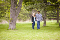 Young Couple Walking in Park, Scanlon Creek Conservation Area, Bradford, Ontario, Canada