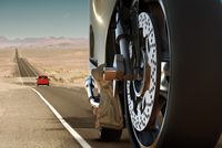 Illustration of close-up view of the wheel of a motorcycle on a road in the desert