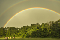 Double Rainbow over Field with Hay Bales on Farm near Madoc, Ontario, Canada
