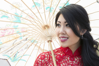 Close-up portrait of young woman holding Chinese parasol, Ontario, Canada