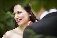 Close-up portrait of bride and groom, standing outdoors, Ontario, Canada