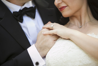 Close-up of bride and groom holding hands, Ontario, Canada