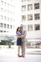 Portrait of couple standing in city courtyard, Toronto, Ontario, Canada