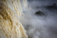 Close-up of waterfall cascading over edge, scenic view of Iguacu Falls, Iguacu National Park, Parana, Brazil