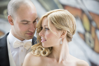 Close-up portrait of bride and groom looking at each other outdoors on Wedding Day, Canada
