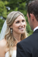 Close-up portrait of Bride with backview of Groom, looking at each other, Canada