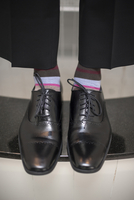 Close-up of men's dress shoes with striped socks, Canada
