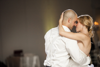 Close-up of Bride and Groom dancing at Reception on Wedding Day, Canada