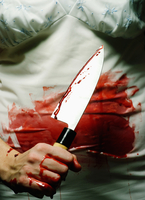 Woman Covered in Blood holding Bloody Knife