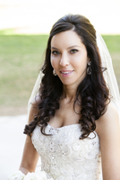 Close-up portrait of Bride in wedding gown, standing outdoors on Wedding Day, smiling and looking at camera, Canada
