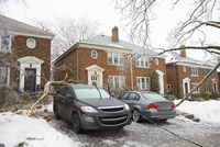 Houses with cars in driveway with power lines damaged by ice storm on city street, Toronto, Ontario, Canada
