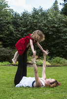 Woman Playing with Daughter Outdoors, Portland, Oregon, USA