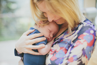 Close-up portrait of mother holding her baby boy, USA