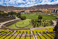 Overview of garden and grounds at Qurikancha, Convent of Santo Domingo, and street scene in background, Cusco, Peru