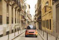 Illustration of small city car in a small alley in Madrid, Spain