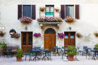 Window Flower Boxes and Planters by Tables in front of Closed Cafe, Pienza, Siena, Val d'Orcia, Tuscany, Italy