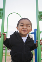 Close-up portrait of smiling little boy at playground, USA