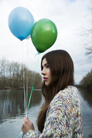 Portrait of Young Woman Outdoors with Balloons, Mannheim, Baden-Wurttemberg, Germany