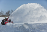 Man on Tractor Snow Blowing at Farm near Madoc, Ontario, Canada