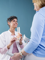 Doctor talking with Senior Patient in Doctor's Office