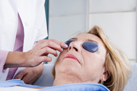 Doctor placing Stones on Senior Patient in Doctor's Office