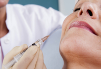 Doctor with Needle about to Inject Patient