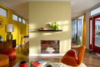Modern home interior, bright and colorful living room with fireplace, Illinois, USA
