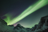 Polar light, Aurora Borealis over Grotfjord at night, Kvaloya, Troms, Norway, Europe