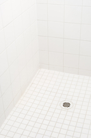 Close-up of empty, white tiled shower stall, USA
