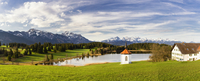 White Chapel by Farm overlooking Small Lake, Fressen, Bavaria, Germany