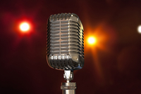 Illustration of close-up of a vintage microphone on a stage, studio shot