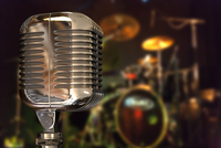 Close-up of Illustration of vintage microphone on a music stage, studio shot
