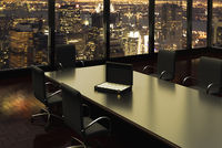 Illustration of briefcase full of money inside an office on boardroom table, view of New York City through window, New York, USA