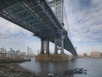 View of Manhattan from under the Manhattan Bridge, from Main Street Park in winter, New York City, New York, USA