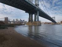 View of Manhattan and Brooklyn Bridge from under the Manhattan Bridge, East River, Main Street Park in winter, New York City, Ne