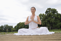 Mature Woman doing Yoga in Park in Summer, Bavaria, Germany