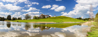 Reflection of Farm Building and Chapel in Spring, Lake Hegratsrieder See, Halblech, Swabia, Bavaria, Germany